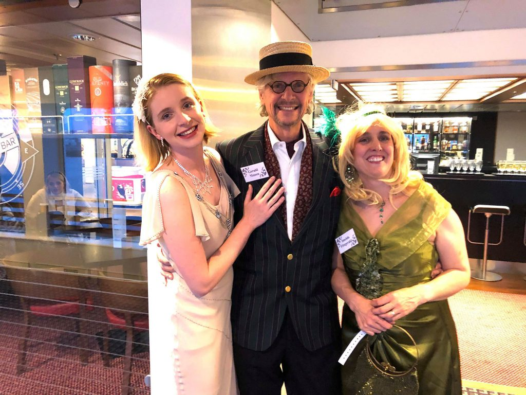 Three People dressed up for a murder mystery
