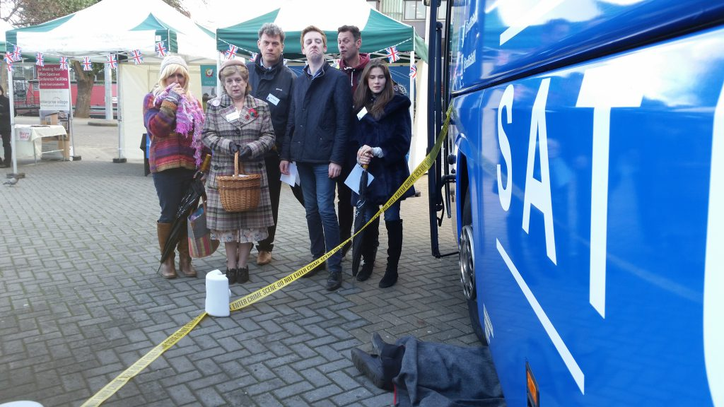 A murder mystery as a group investigate a body under a bus