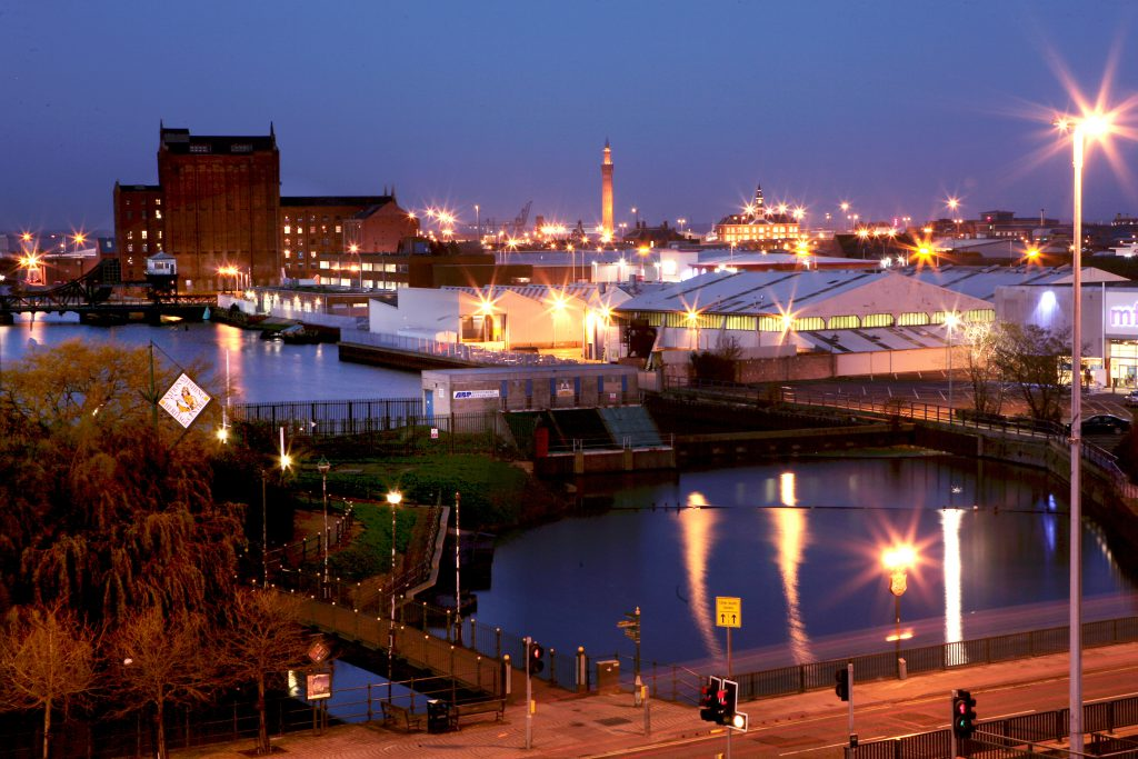 Grimsby skyline at night, lit up with the Dock Tower in the distance.