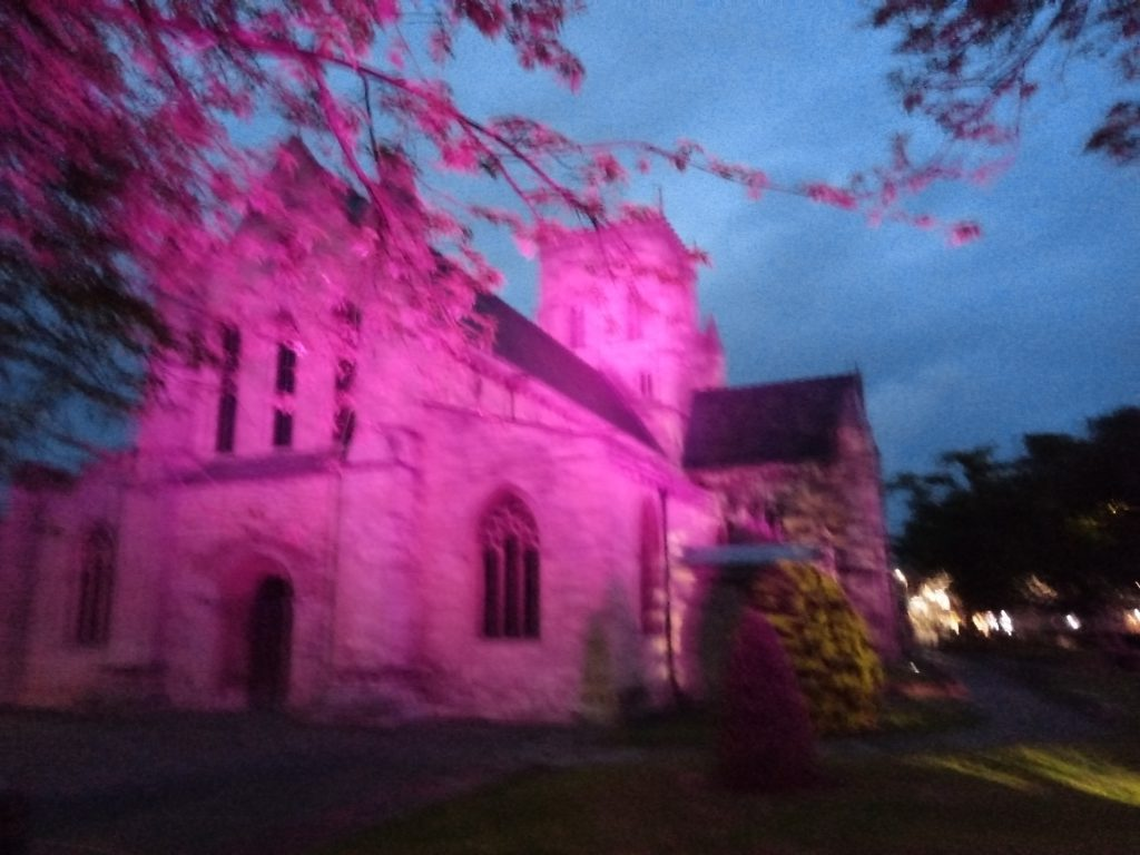 Grimsby Minster lit up in red