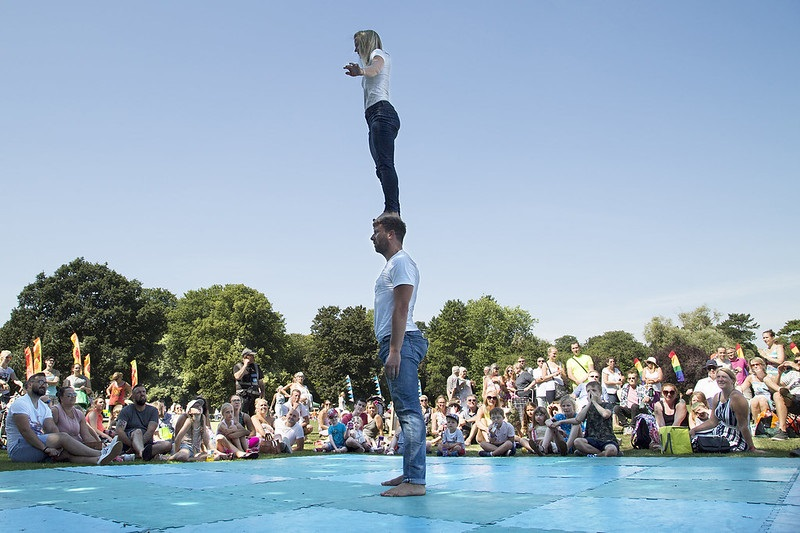 An acrobatic performance with someone standing on the head of another person