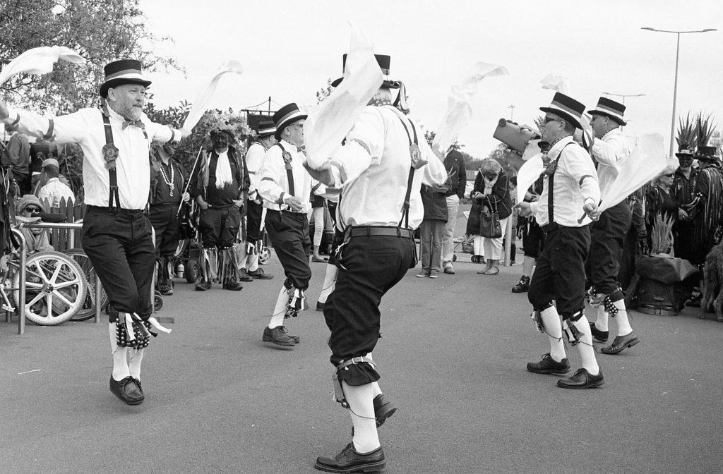 Morris dancers dancing.