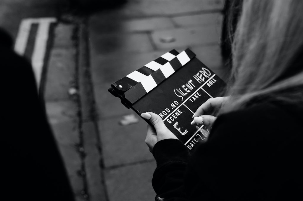 A director's clapper board, with words 'silent hero' on