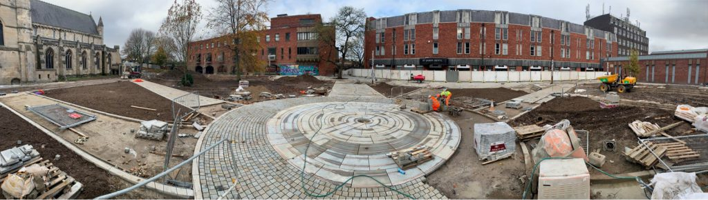 Panarama of St James' Square. Circular labyrinth in the middle.