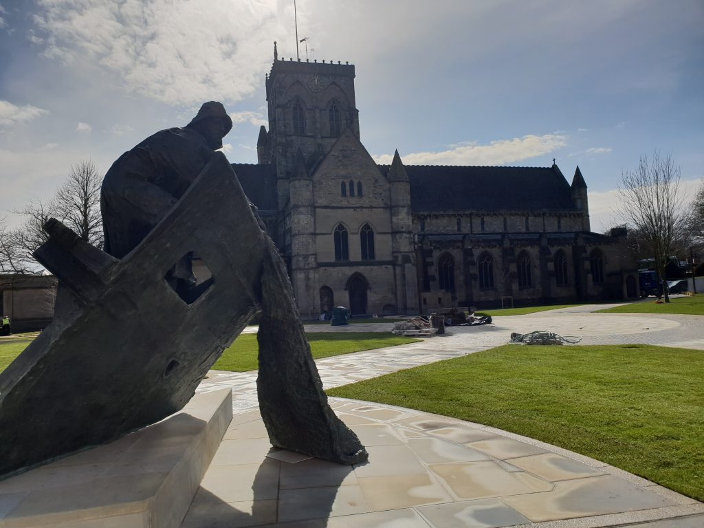 Statue of a fisherman in front of Grimsby Minster
